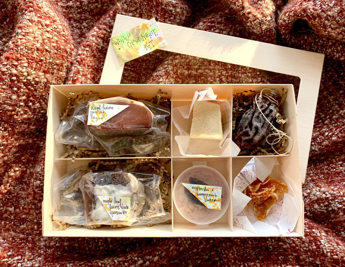 A box filled with different charcuterie items