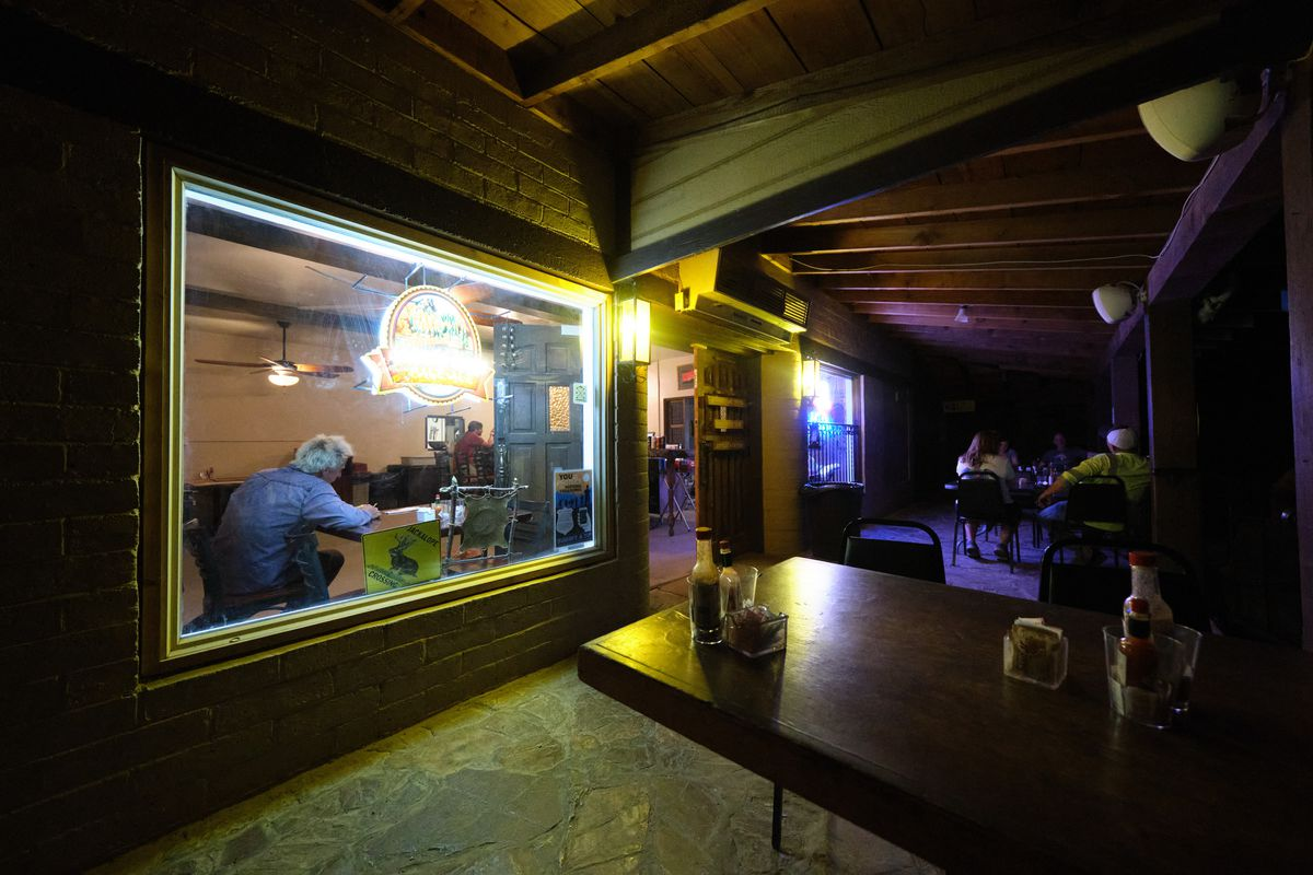 the view through a window into the bar at night.