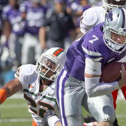 Kansas State quarterback Collin Klein (7) gets away from Miami defensive back Kacy Rodgers II (22) during the first half of an NCAA football game in Manhattan, Kan., Saturday, Sept. 8, 2012.