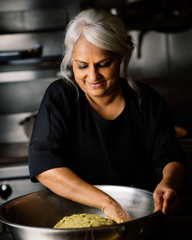 Chef Heena Patel mixing dough by hand
