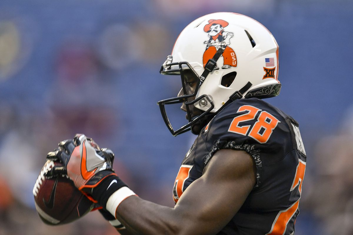 ORLANDO, FL:  Oklahoma State Cowboys wide receiver James Washington (28) warms up prior to the 2017 Camping World Bowl game against the Virginia Tech Hokies at Camping World Stadium.