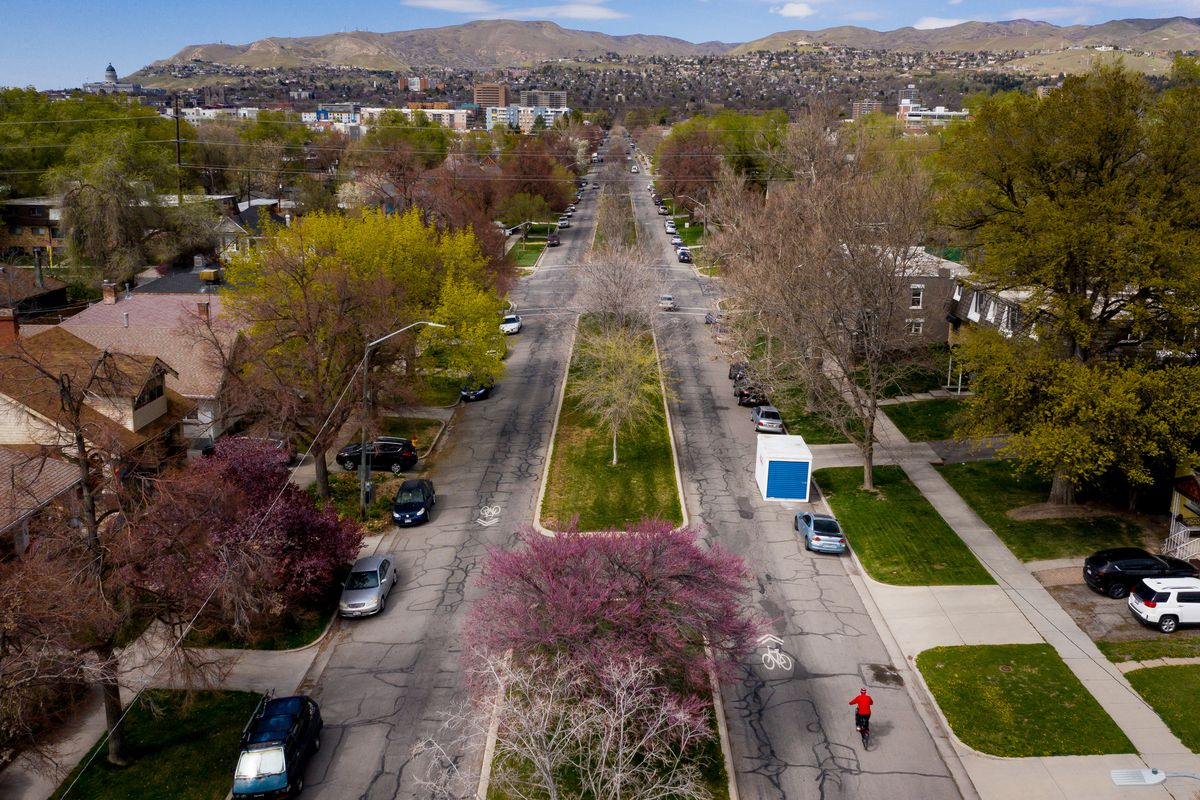 A cyclist rides on 600 East in Salt Lake City on Tuesday, April 14, 2020. The city is considering restricting some streets, such as 600 East, to local auto traffic only in an effort to make them more bike and pedestrian friendly.