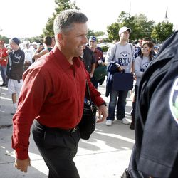 Utah Head Coach Kyle Whittingham walks into the stadium to a few calls from BYU and Utah fans as BYU and Utah play Saturday, Sept. 17, 2011