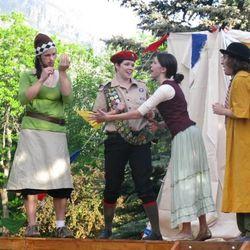 A scheme is hatched by Audrey (Nick Grossaint), left, Rosalind (Heather Murdock), Celia (Aubrey Bench) and Touchstone (Davey Morrison Dillard).