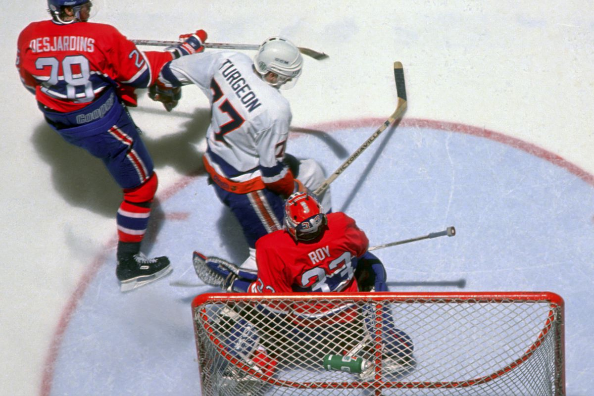 Patrick Roy is run into by Pierre Turgeon...