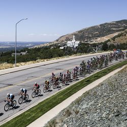 The peloton rides along Bountiful Boulevard during Stage 3 of the Tour of Utah near Bountiful on Thursday, Aug. 15, 2019.