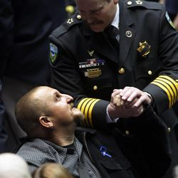 Injured Weber County Sheriff's Sgt. Nate Hutchinson is greeted prior to funeral services for Ogden police officer Jared Francom in Ogden Wednesday, Jan. 11, 2012. Francom, a seven-year veteran of the force, was killed in the line of duty on Jan. 4, while serving a warrant. Five other law enforcement agents were wounded on the scene.