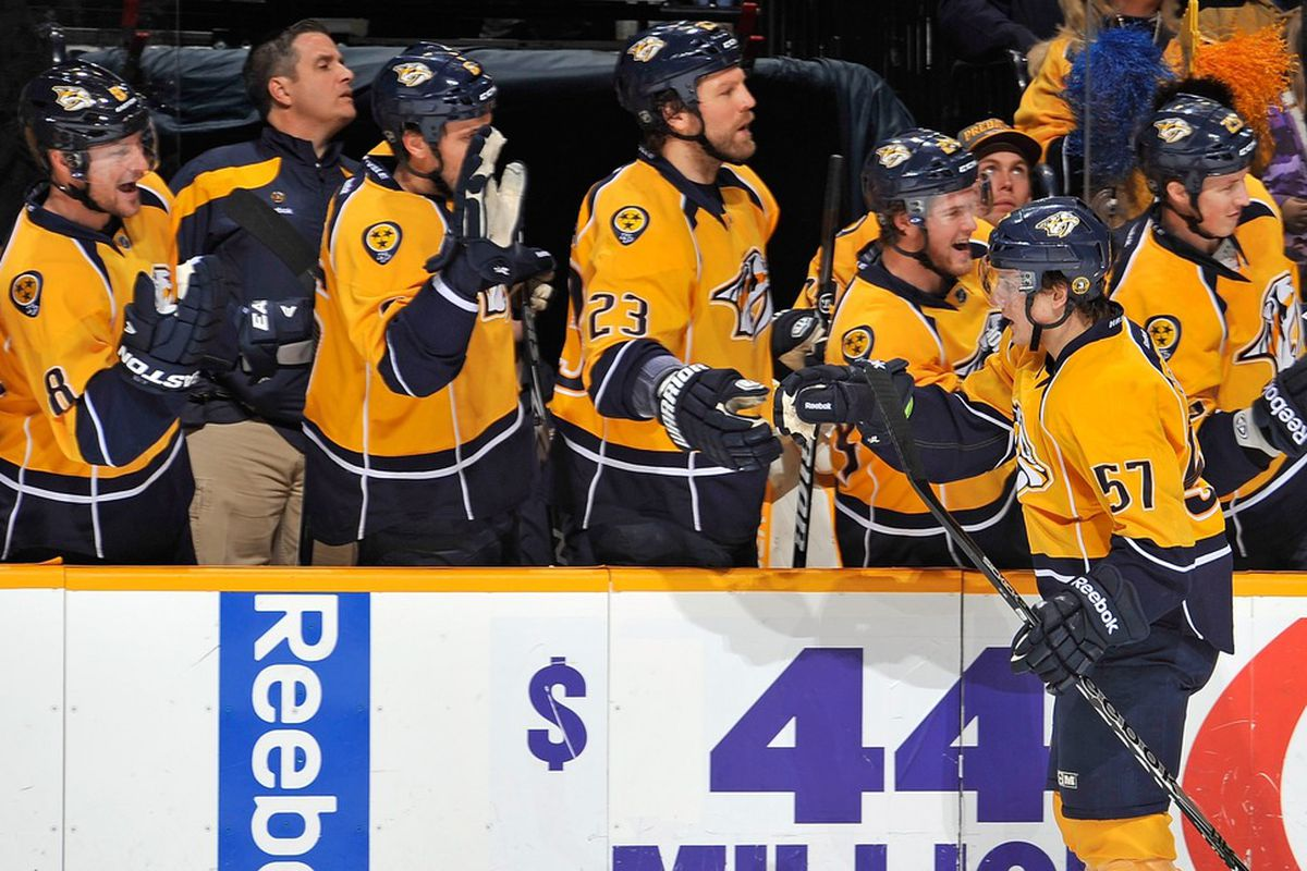 NASHVILLE, TN - JANUARY 15:  Gabriel Bourque #57 of the Nashville Predators is congratulated by his teammates for being named OTF Hero Of The Week.