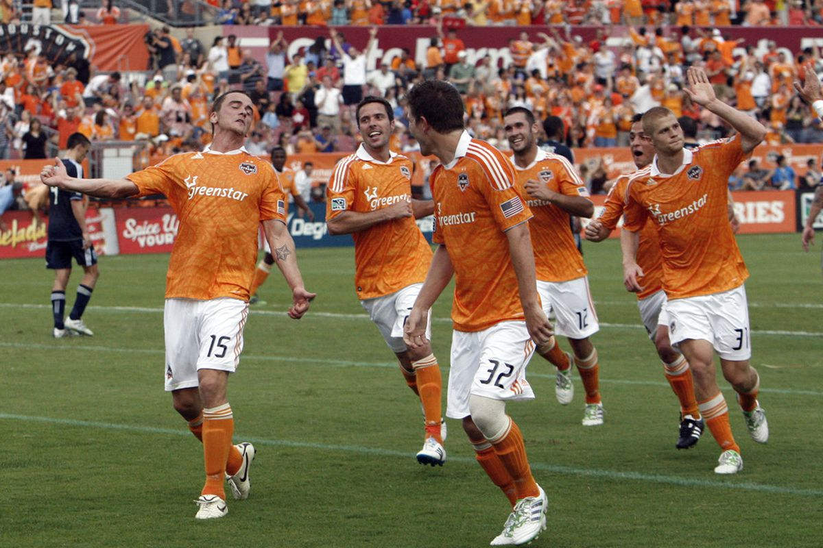 HOUSTON - APRIL 10:  Cam Weaver #15 of the Houston Dynamo celebrates his first half goal against the Vancouver Whitecaps at Robertson Stadium on April 10, 2011 in Houston, Texas.  (Photo by Bob Levey/Getty Images)