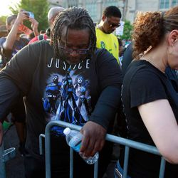 Attendees bow their heads in prayer. | Jim Young/Getty Images