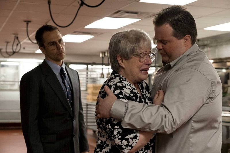 Kathy Bates cries in Paul Walter Hausner's arms while Sam Rockwell watches in a scene from the new movie Richard Jewell.