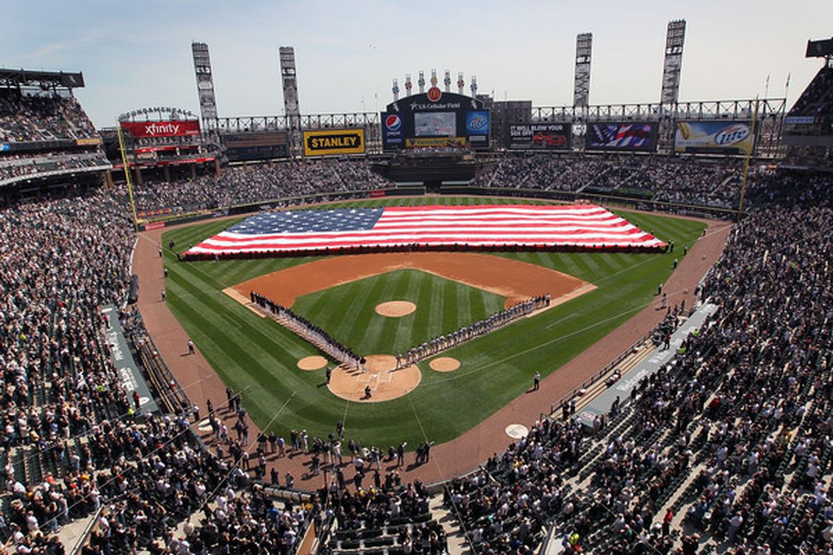 CHICAGO - APRIL 05:  Fans and players listen to the National Anthem before the Chicago White Sox game against the Cleveland Indians on Opening Day at U.S. Cellular Field on April 5, 2010 in Chicago, Illinois.  (Photo by Scott Olson/Getty Images)