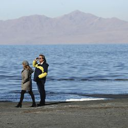 A couple walks near at the Great Salt Lake on Wednesday, Oct. 28, 2020. A new study shows water conservation could put off the need for new water development by as long as 2065 and help save the dwindling Great Salt Lake.