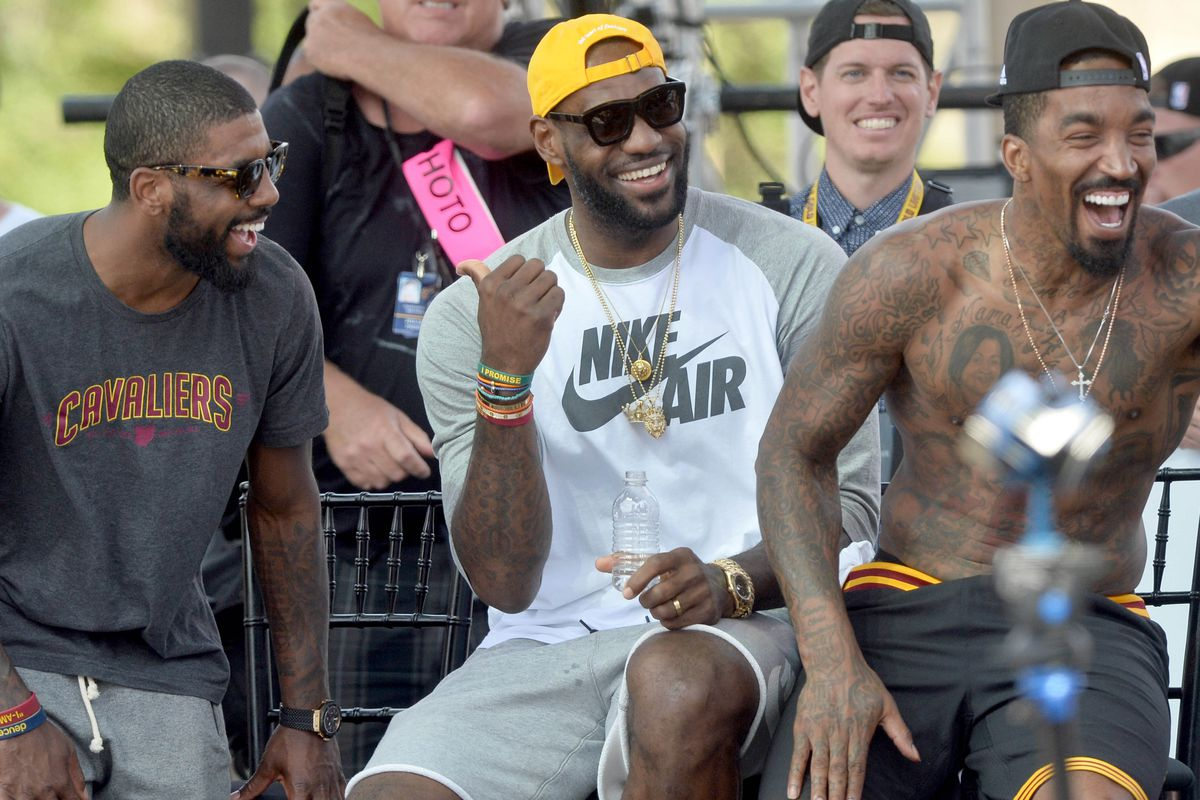 Jun 22, 2016; Cleveland, OH, USA; Cleveland Cavaliers guard Kyrie Irving, forward LeBron James and guard J.R. Smith laugh during the Cleveland Cavaliers NBA championship celebration in downtown Cleveland.