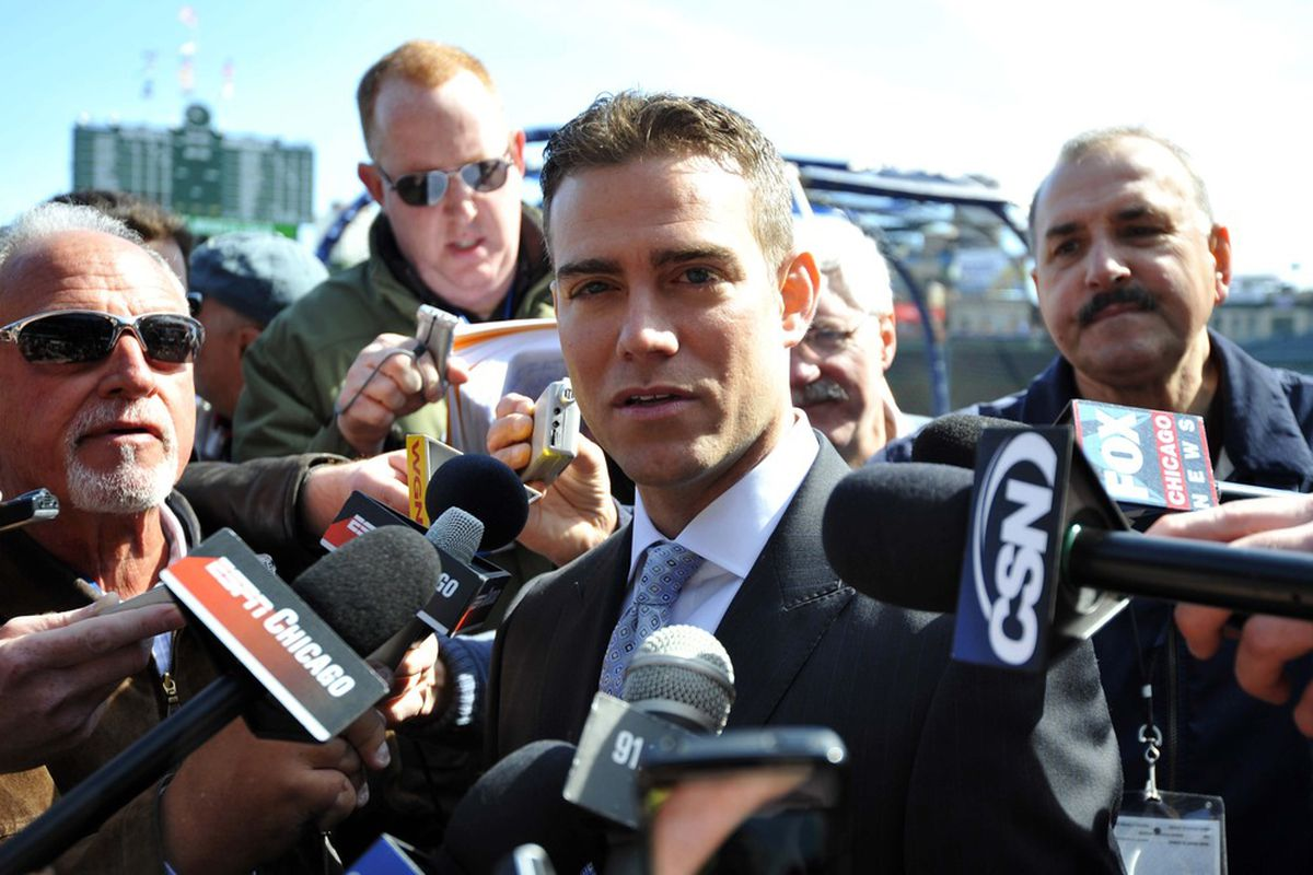 April 5, 2012; Chicago, IL, USA; Chicago Cubs president of baseball operations Theo Epstein talks to the media before the game against the Washington Nationals on opening day at Wrigley Field.  Mandatory Credit: Rob Grabowski-US PRESSWIRE