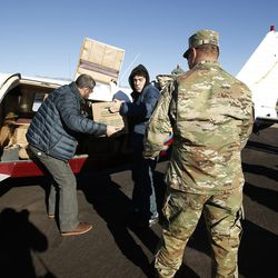 Santa Flight volunteers unload after landing with Christmas gifts for students at Hurricane Elementary School in Hurricane on Wednesday, Dec. 7, 2016. Pilots with the Utah Wing of Angel Flight West filled 16 aircraft with 7,000 pounds toys, school supplies, books, backpacks and warm clothing for students at the Title I school. The items were gathered by 16 Boy Scouts as part of their Eagle Scout service project. Since the first Santa Flight in 2000, members of the Utah Wing have worked with their local communities to gather needed supplies and toys, and deliver them to Title I schools in rural communities throughout Utah.