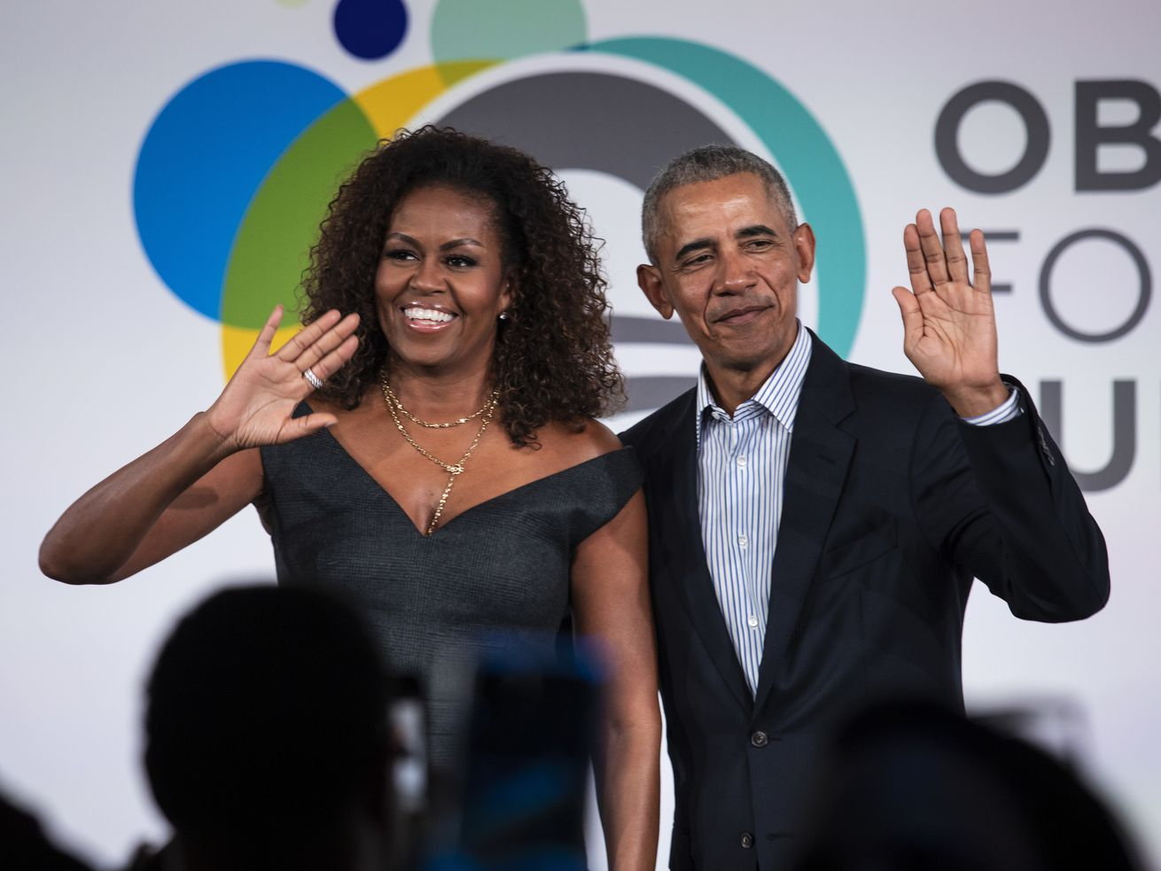 Former President Barack Obama and first lady Michelle Obama appear at the Obama Foundation Summit in Chicago on Oct. 29.