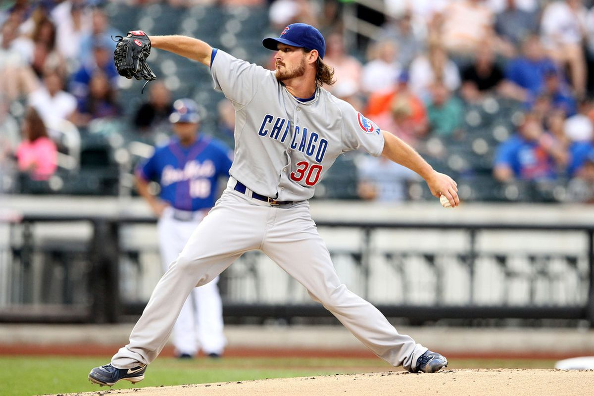 July 6, 2012; New York, NY, USA; Chicago Cubs pitcher Travis Wood (30) throws a pitch during the first inning of a game against the New York Mets at Citi Field. Mandatory Credit: Brad Penner-US PRESSWIRE