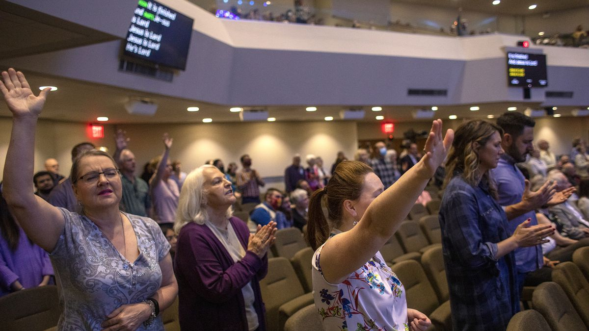 Parishioners raise their hands in worship during a service at Kingsland Baptist Church in Houston on Sunday, March 28, 2021.