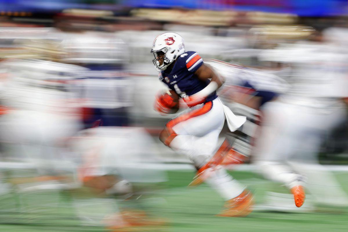Auburn's Noah Igbinoghene returns a kick in the 2018 Peach Bowl.