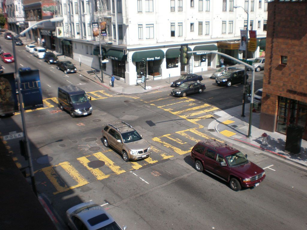 An aerial view of a San Francisco city street with cars.