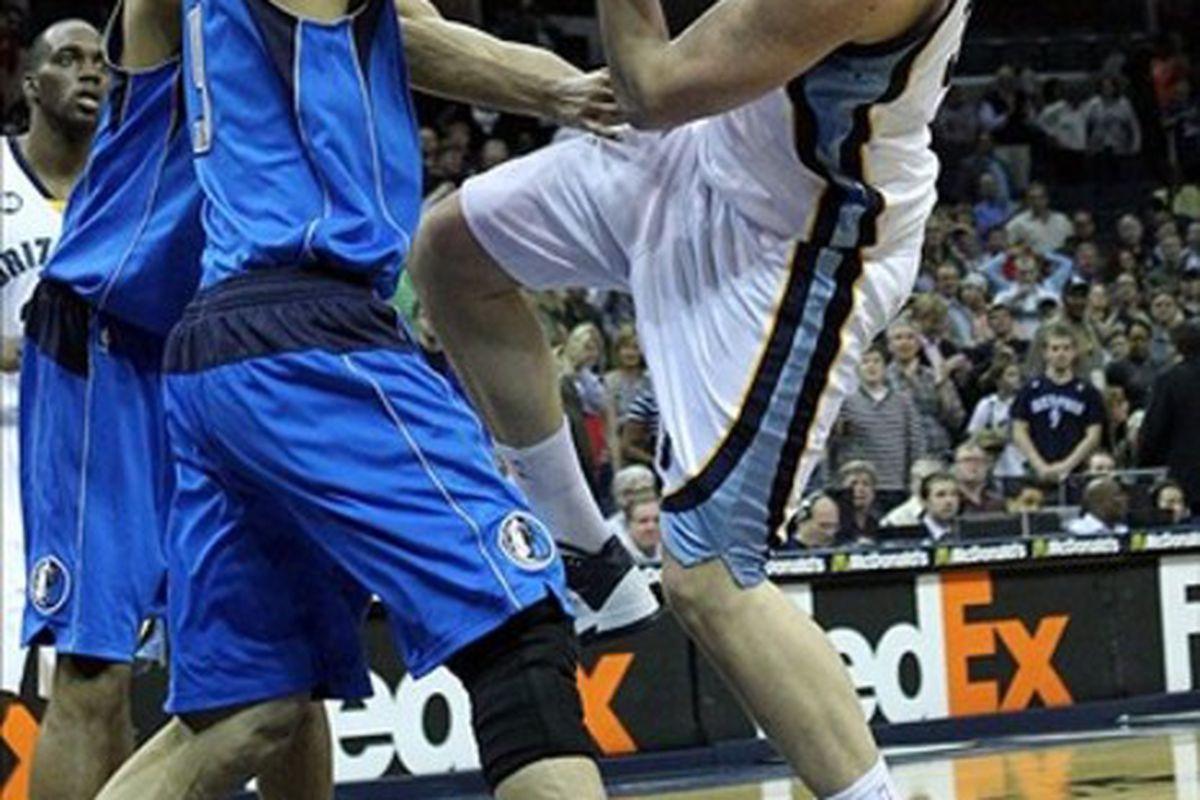 Memphis Grizzlies center Marc Gasol is fouled by Dallas Mavericks forward Yi Jianlian. He is not Jeremy Lin.  Mandatory Credit: Nelson Chenault-US PRESSWIRE