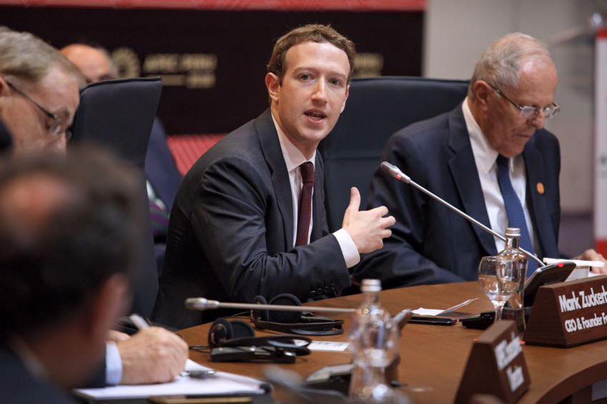 Facebook CEO Mark Zuckerberg in a suit and tie, speaking at a hearing.