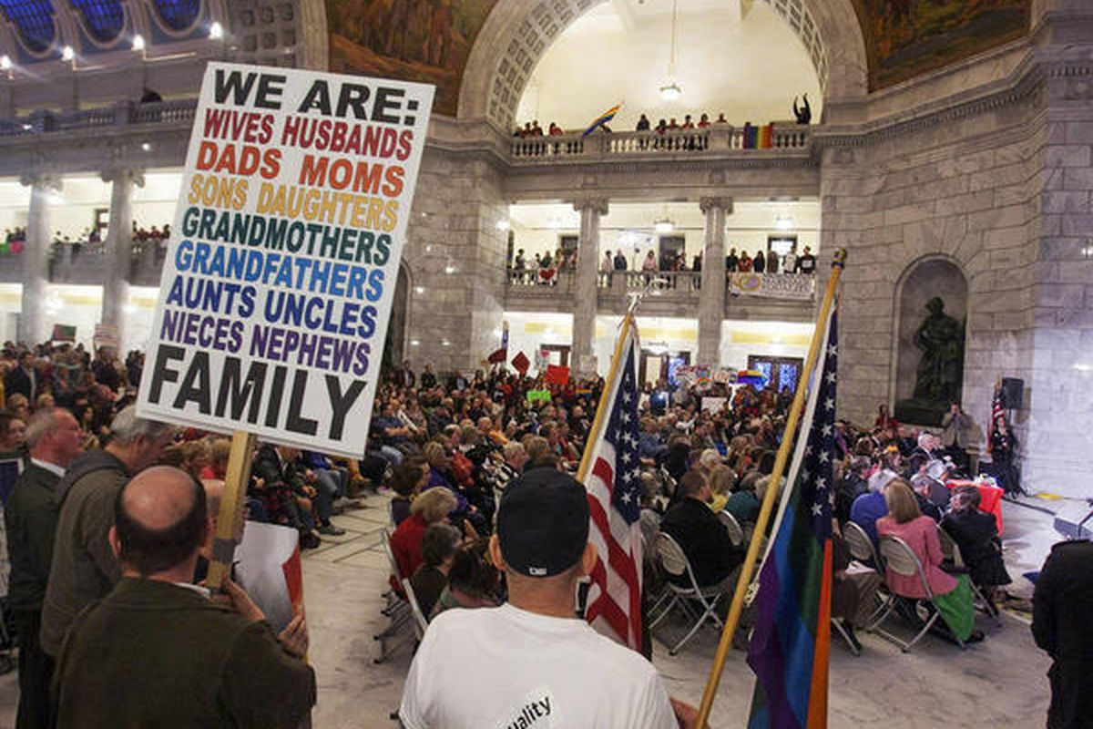Traditional marriage supporters and same-sex marriage supporters gather at Tuesday, March 26, 2013, at the state Capitol in Salt Lake City. A new study finds that the Utah capital and its outskirts have the nation's highest percentage of gay or lesbian co