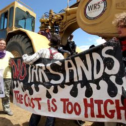 Activists from a number of environmental and social justice groups shut down construction Monday, July 29, 2013.