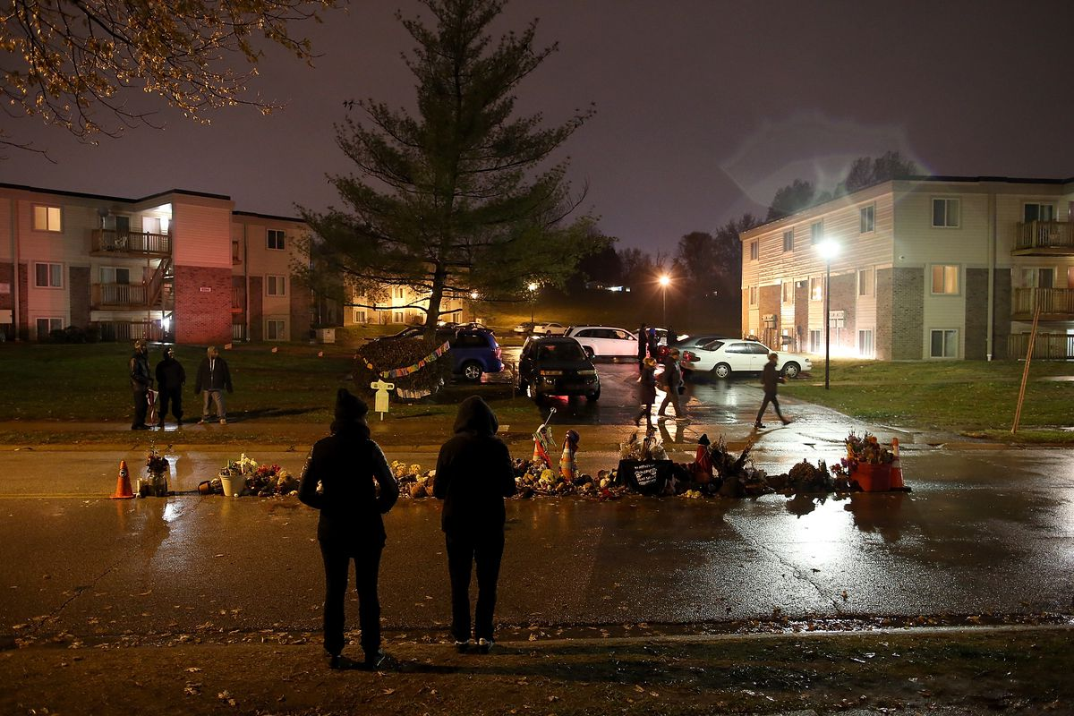 People look over a memorial for Michael Brown, an unarmed black 18-year-old killed by a Ferguson, Missouri, police officer.