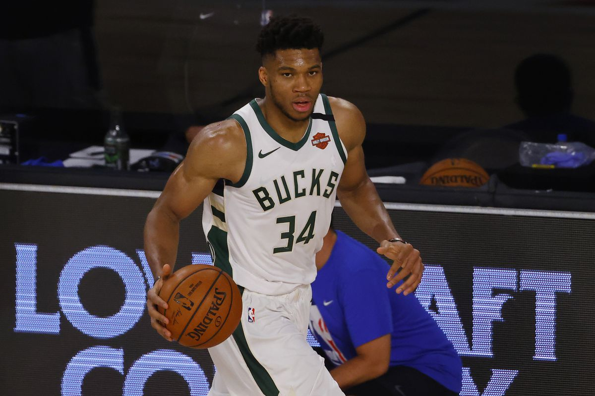 Giannis Antetokounmpo of the Milwaukee Bucks moves the ball up court against the Orlando Magic in Game Three of the Eastern Conference First Round during the 2020 NBA Playoffs at The Field House at ESPN Wide World Of Sports Complex on August 22, 2020 in Lake Buena Vista, Florida.