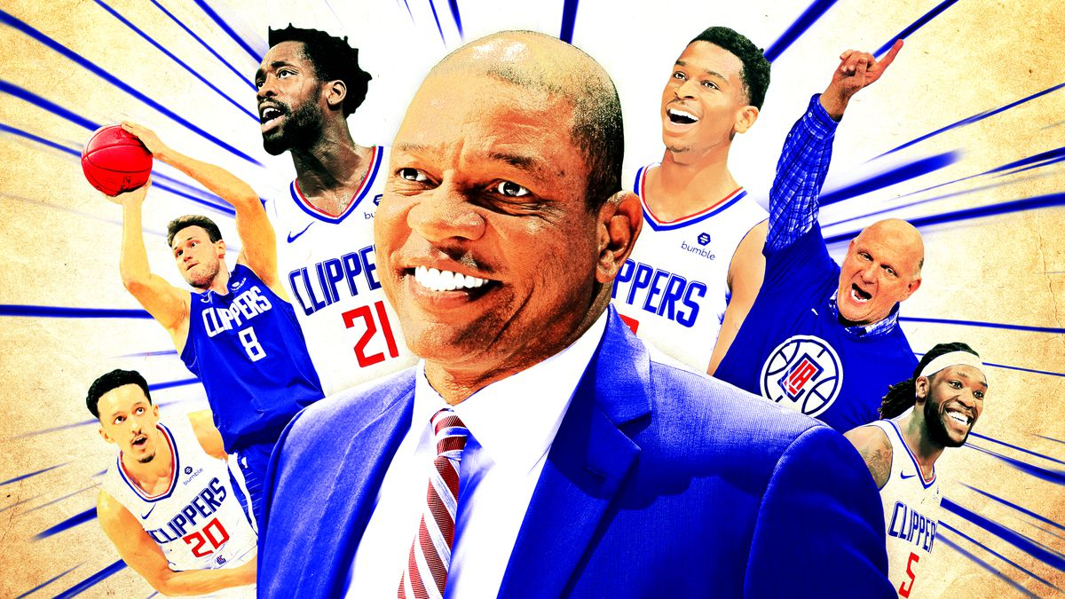 Doc Rivers surrounded by Clippers players