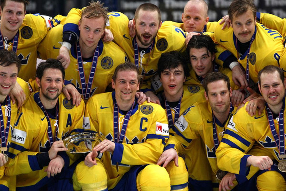 COLOGNE, GERMANY - MAY 23:  The team of Sweden celebrate after winning the IIHF World Championship bronze medal match between Sweden and Germany at Lanxess Arena on May 23, 2010 in Cologne, Germany.  (Photo by Martin Rose/Bongarts/Getty Images)