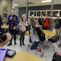 Air Force Tech Sgt. Edward Goettig reveals himself to his daughter Bailee at Lehi High School on Thursday, March 6, 2014. Goettig had been deployed to Afghanistan since Aug. 27, 2013.