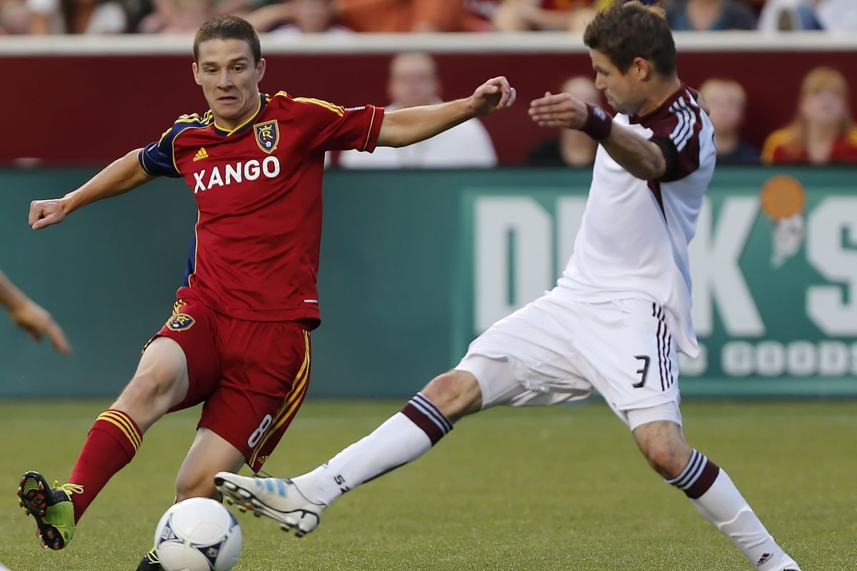 SANDY, UT - JULY 21: Will Johnson #8 of Real Salt Lake and Drew Moor #3 of the Colorado Rapids fight for the ball during the second half of an MLS soccer game July 21, 2012 at Rio Tinto Stadium in Sandy, Utah. (Photo by George Frey/Getty Images)