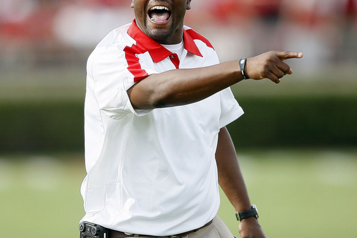HOUSTON - SEPTEMBER 03:  Head coach Kevin Sumlin of the Houston Cougars attempts to get the attention of the referee at Robertson Stadium on September 3, 2011 in Houston, Texas.  (Photo by Bob Levey/Getty Images)