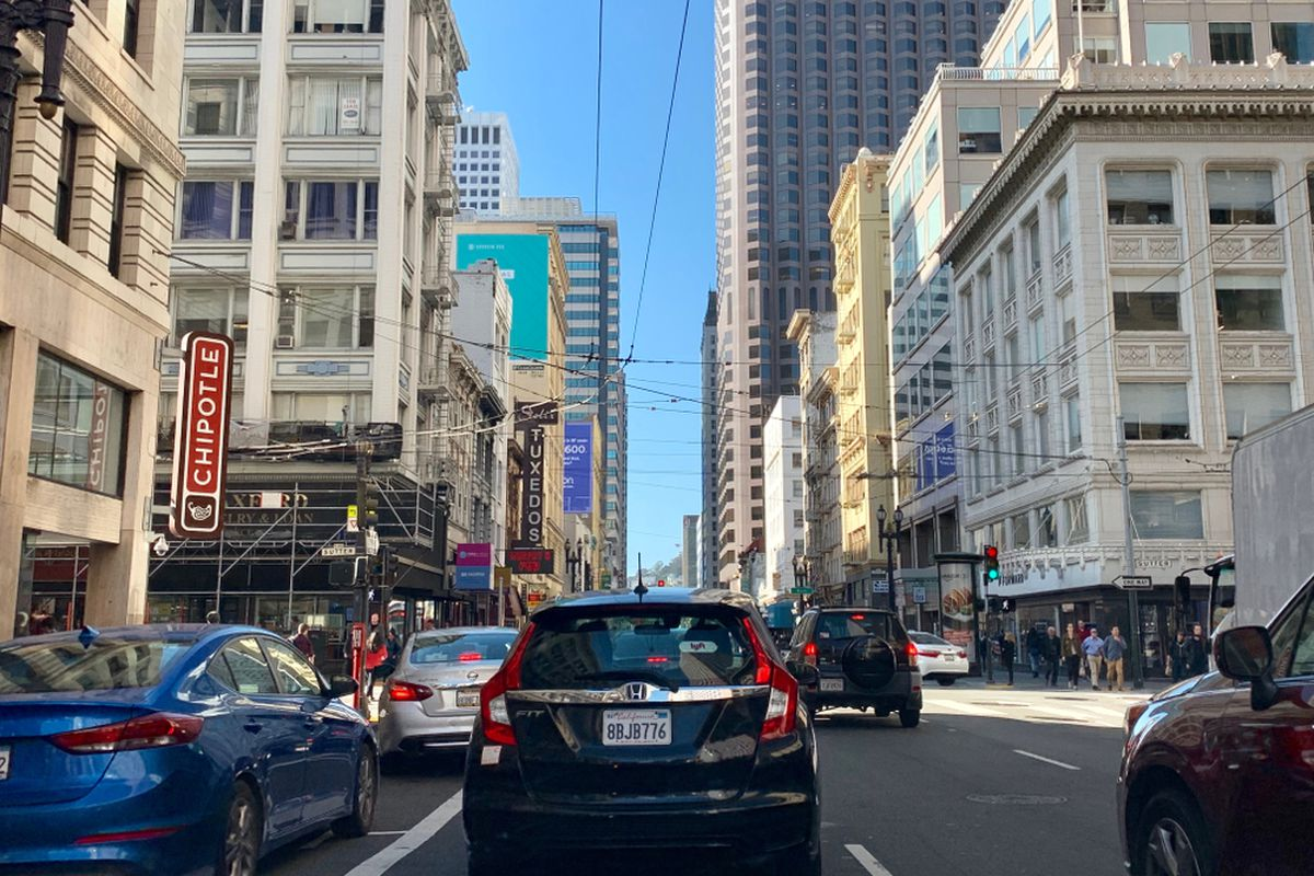 The back bumpers of cars linked up on Kearny Street in downtown San Francisco.