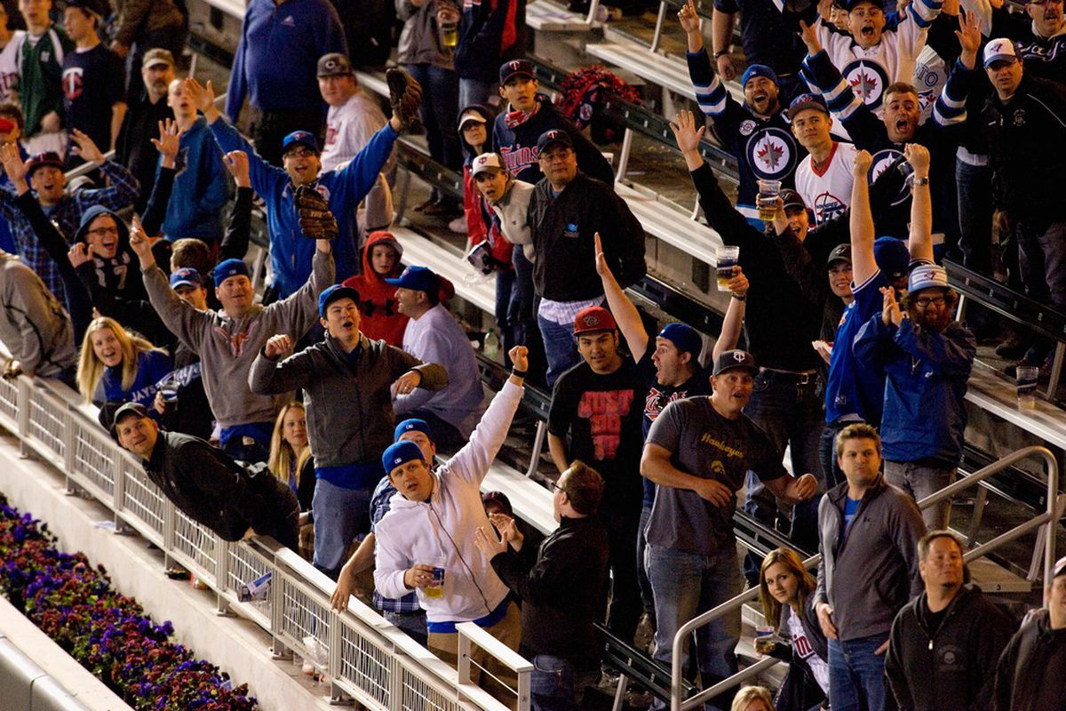 Blue Jays (and Jets) fans cheer on Jose Bautista at Target Field after he slammed a homer against the Minnesota Twins. (Photo by Hannah Foslien/Getty Images)
