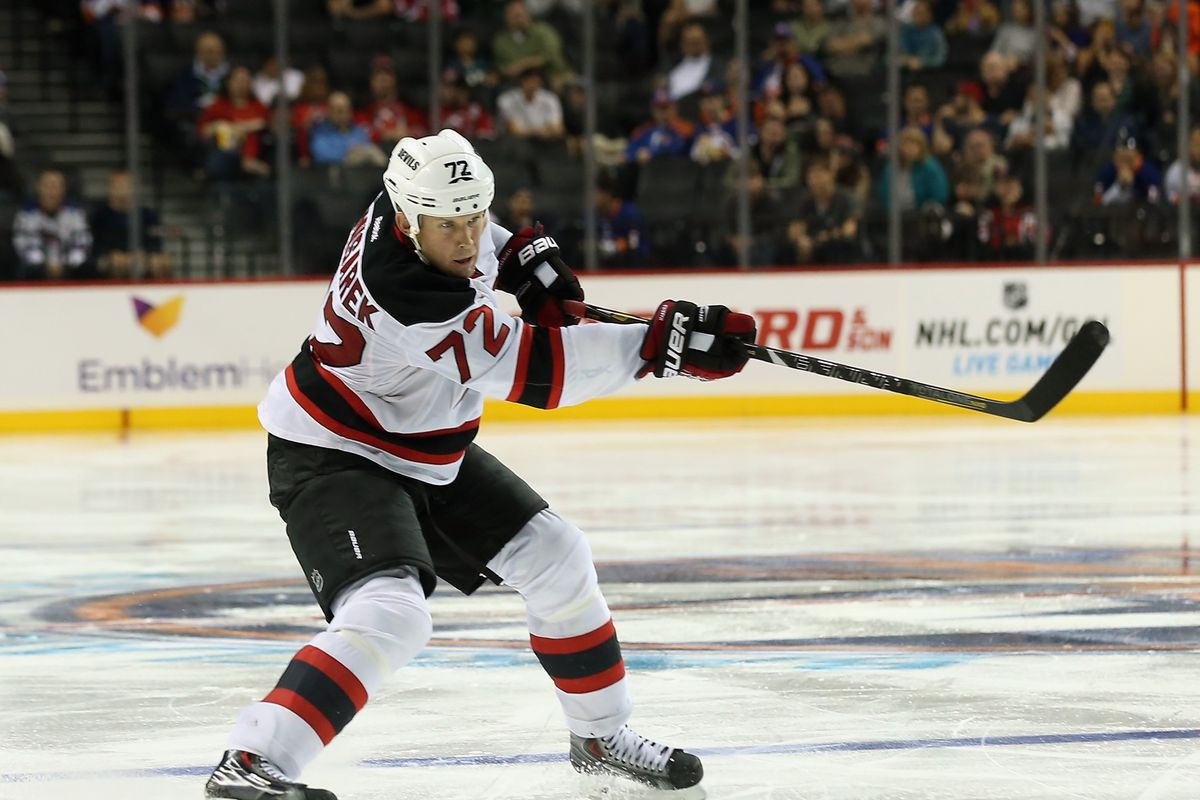 Mike Komisarek will not be a New Jersey Devil this season.  He got released today.