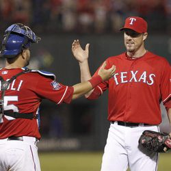 Texas Rangers closer Joe Nathan, right, is congratulated by catcher Mike Napoli (25) after the Rangers' 1-0 win over the Seattle Mariners in a baseball game Tuesday, April 10, 2012, in Arlington, Texas.