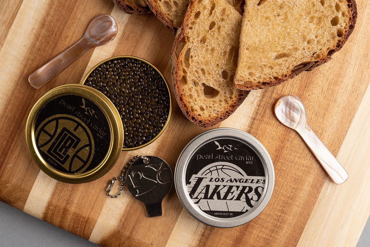 NBA caviar with Clippers and Lakers logos on a wood board