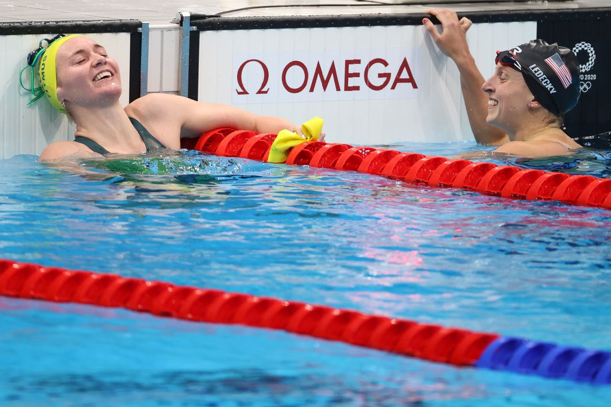 Ariarne Titmus of Team Australia and Katie Ledecky of Team United States react after winning gold and silver in the Women's 400 meter freestyle on day three of the Tokyo 2020 Olympic Games at Tokyo Aquatics Centre on July 26, 2021 in Tokyo, Japan.