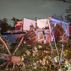 Tornado damage at the corner of Woodridge Dr. And Jonquil Ln. in Woodridge early Monday morning.