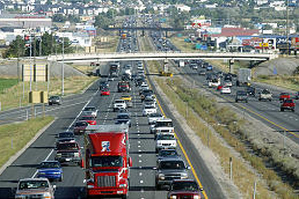 Heavy traffic creeps along I-15 near Pleasant Grove, looking southeast. The county is growing by about 15,000 people each year.
