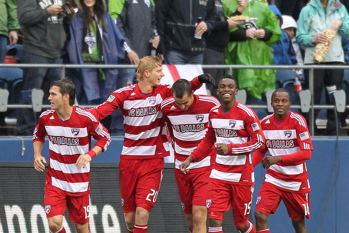 SEATTLE - MAY 25:  Brek Shea #20 of FC Dallas celebrates with teammates after scoring a goal against the Seattle Sounders FC at Qwest Field on May 25, 2011 in Seattle, Washington. (Photo by Otto Greule Jr/Getty Images)