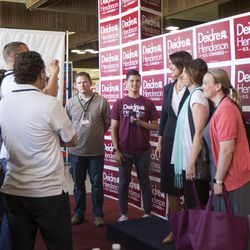 State Sen. Deidre Henderson poses with supporters in front of her booth while campaigning for the vote of Republican delegates at Timpview High School in Provo on Saturday, June 17, 2017.
