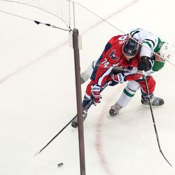 Roussel Fights Carlson For Puck