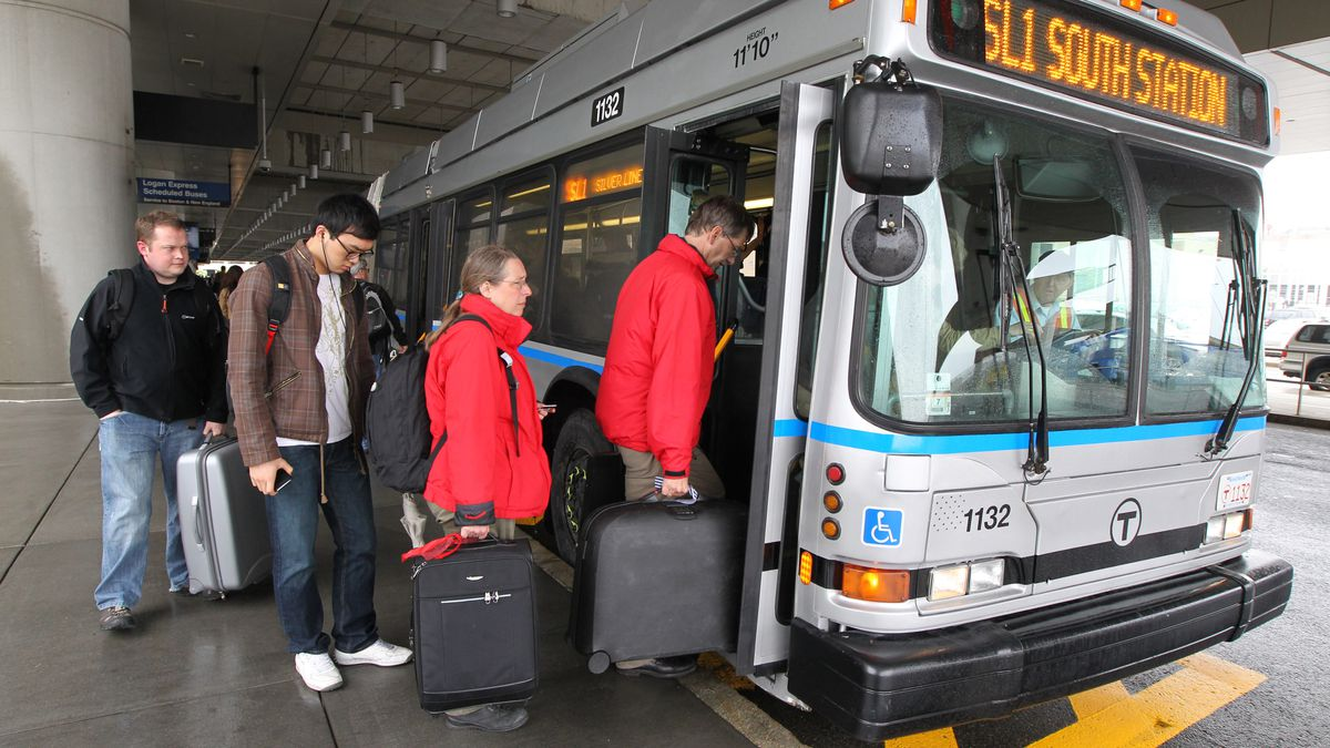 Riders lining up to board a city bus.