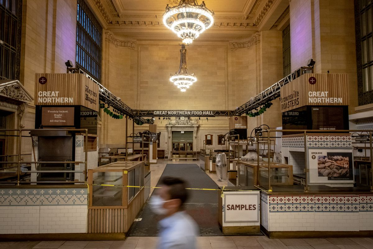 A man walks past a food hall inside Grand Central Terminal
