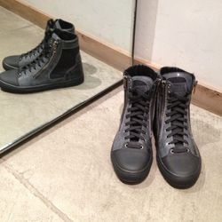 Black leather and felt double zip high-tops by Margiela. Originally $825, now $412